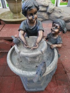 kids and water fountain