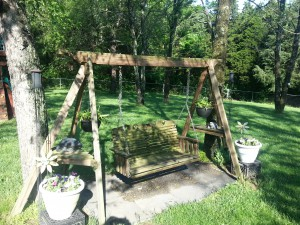 Backyard wooden swing on stand