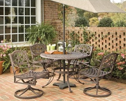 Four Chairs and a Round Outdoor Dining Table for Your Patio or Deck