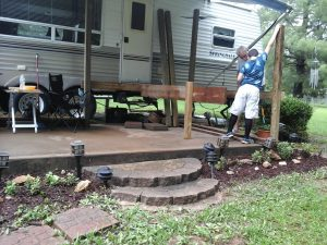 Chris helping build deck at camper