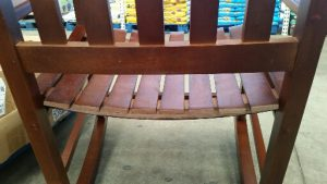 Back of wooden rocker seat