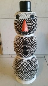 Filled snowman bird feeder