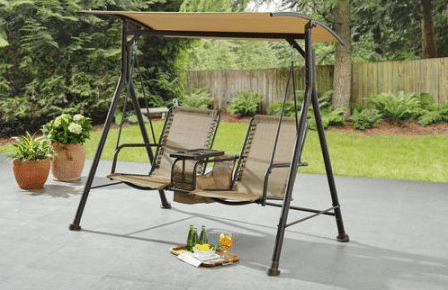 Ozark Trail Big and Tall patio swing with table and canopy tan