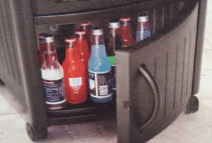 Suncast resin wicker cooler bottom storage
