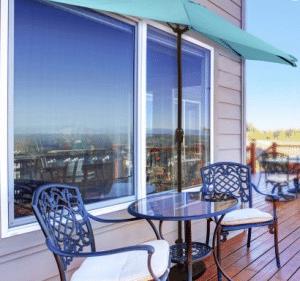 small patio sets for balconies-Half umbrella on balcony