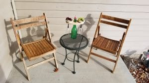 Teak folding chairs with table top wine bottle holder