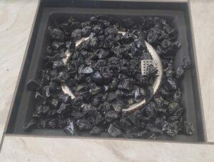 River Oaks fire bowl with black glass rocks